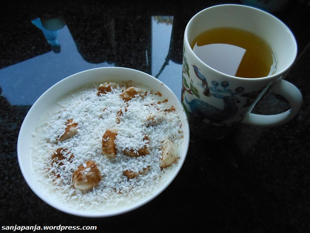 Breakfast: Yogurt, banana, cinnamon and shredded coconut with a cup of green tea.